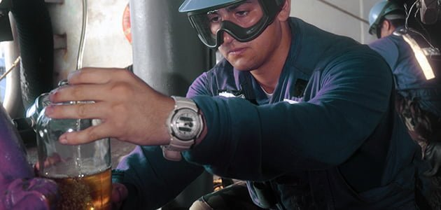 a man holding a fuel contamination in the bottle