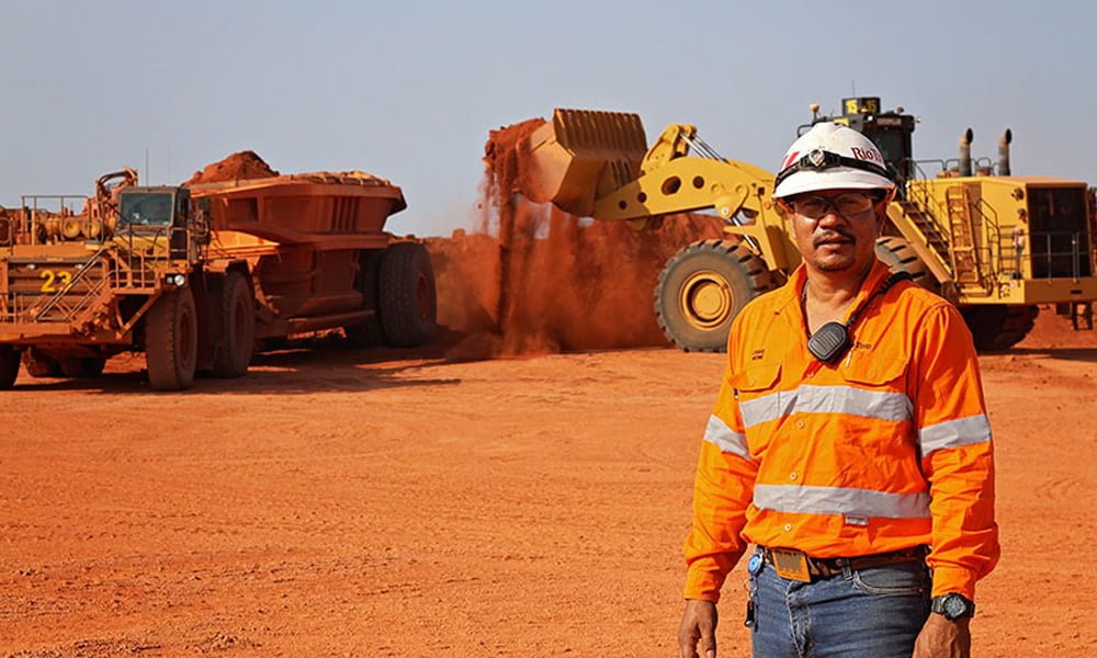 rio tinto amrun and a man standing with uniform